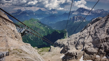 Cable car cables and wheels against steep ascent, Marmolada Peak