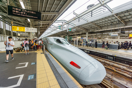 TOKYO, JAPAN - JUNE 03, 2015: A Shinkansen Bullet Train in Tokyo, Japan. The Shinkansen is the worlds busiest high-speed rail line