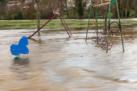 Flooding and swing park Stock Photo