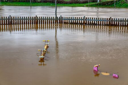 Flooding and swing park under the water Stock Photo