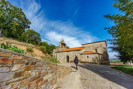 Believer walking towards Pobladura de Aliste church Stock fotó