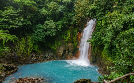 Celestial blue waterfall and pond in tenorio national park