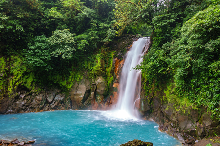Celestial blue waterfall and pond in tenorio national park, Costa Rica