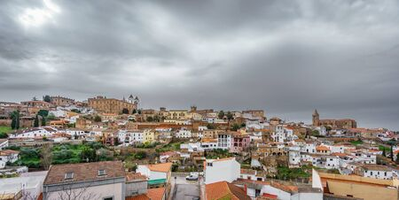 Medieval Caceres with dark cloudy sky