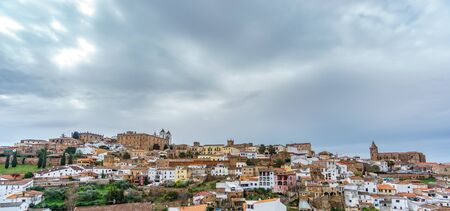 Medieval Caceres panorama with dark cloudy sky
