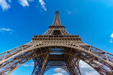The Eiffel Tower bottom view over blue sky Stock Photo