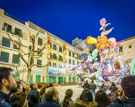 VALENCIA, SPAIN- MARCH 15, 2015: Crowd observe El Pilar Falla in Valencia at dusk, the Fallas is a typical celebration where monuments are built for being burnt in Valencia, Spain