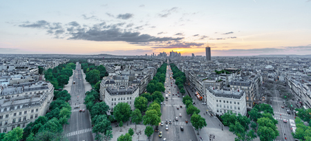 Sunset skyline of Paris with la defense and streets