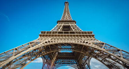 The Eiffel Tower worms eye view over blue sky