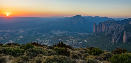 Mallos of Riglos at sunset from top of the mountain Stock Photo