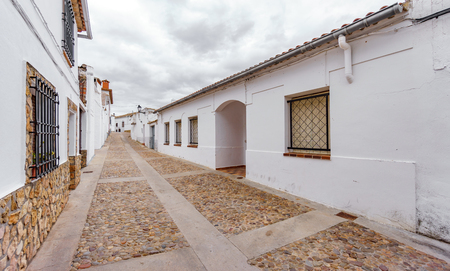 White facades and paved street