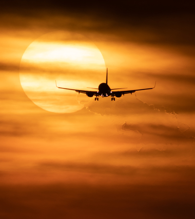 Beautiful sunset with jetTravel concept