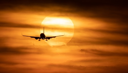 Beautiful sunset with airplane. Travel concept