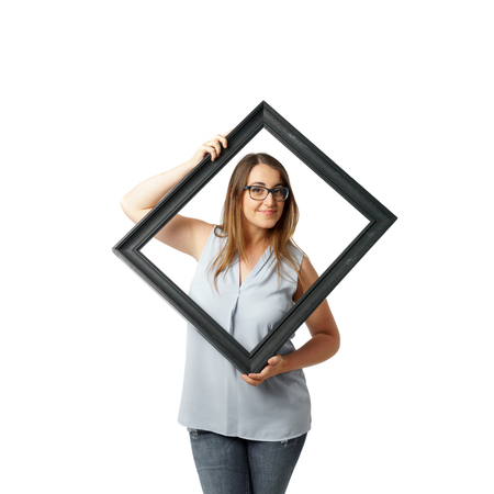 Woman with glasses behind crooked black frame