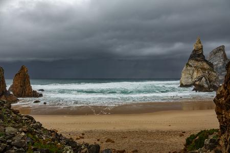 Praia da Ursa beach with stormy clouds