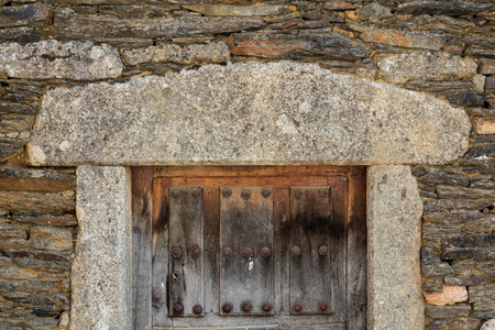 Granite frame, stone facade and vintage wooden door Stok Fotoğraf