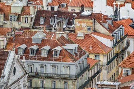 Lisbon run-down roofs long shot view with different colors