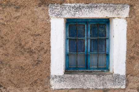 Old blue wooden window frame with grille Stok Fotoğraf