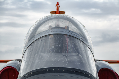 Front view of jet plane cockpit against cloudy sky