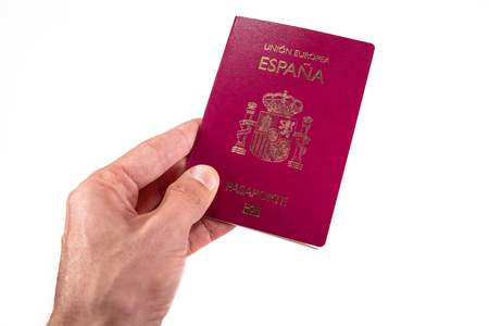 Caucasian man left hand offering spanish passport