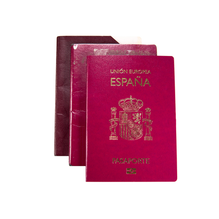 New spanish passport over old expired ones