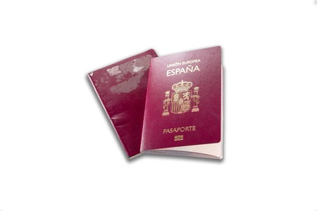 New spanish passport over old expired one, white background Stok Fotoğraf