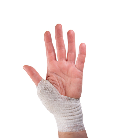 Caucasian woman left hand palm with surgical dressing