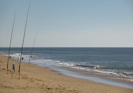 Fishing rods fishing in the beach with clear horizon 版權商用圖片