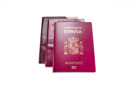 New spanish passport over old expired ones and white background