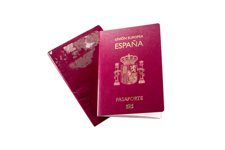 New spanish passport over old rusty expired one, white background