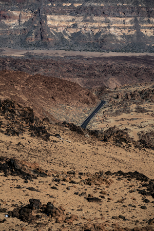 Road across crater of lava in Tenerife, vertical composition
