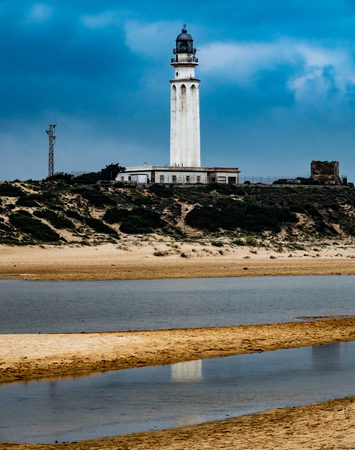 Trafalgar lighthouse in Cadiz with cloudy sky