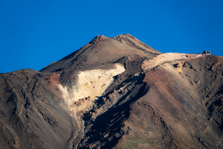 Teide volcano crater with snow against deep blue sky