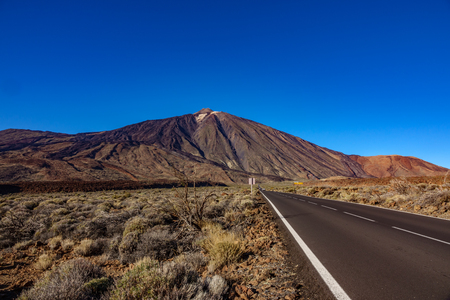 Straight road and Teide volcano in Tenerife