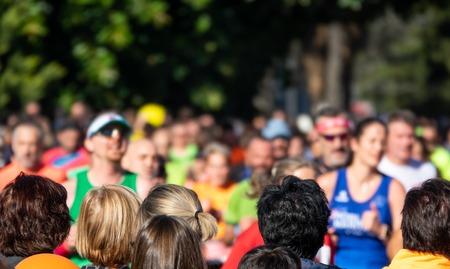Public heads contemplate city marathon runners