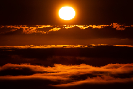 Sun and clouds at sunset, aerial view