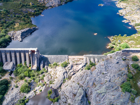 Aerial view of broken dam in Sanabria, Spain