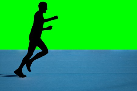 Fast marathon runner silhouette with green background