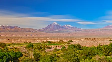 Long exposure with cotton clouds over Licancabur volcano
