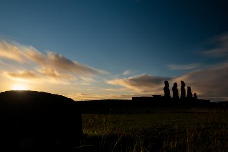 Moai shilouette in the Ahu Tahai at sunset, profile view