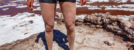 Man legs with salt after swimming in Atacama salt lakes Reklamní fotografie - 123606777