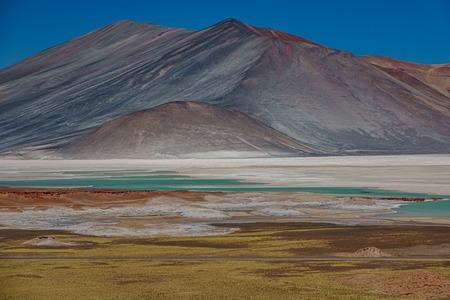Spectacular red stones and Talar salar in Atacama Reklamní fotografie