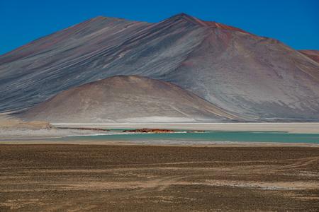 Unreal red stones and Talar salar in Atacama Reklamní fotografie