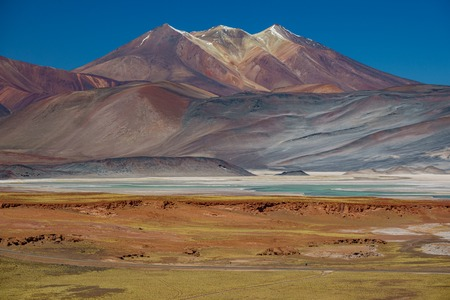 Spectacular red stones and Talar salar in Atacama near Bolivia