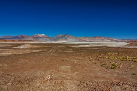 Red stones and Talar salar in Atacama