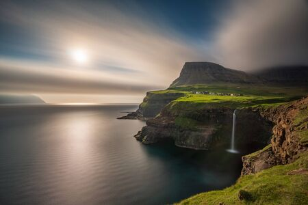 Wide angle view of Gasadalur waterfall long exposure in Faroe Islands, Vagar island