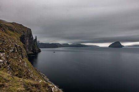 Long exposure of Trollkonufingur, Witchs Finger edge in Faroe Islands