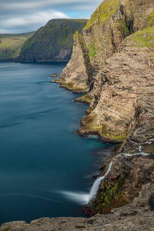 Bosdalafossur waterfall vertical composition long exposure, Faroe Islands