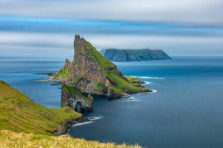 Amazing top view long exposure of Drangarnir gate in front of Tindholmur, Faroe Islands