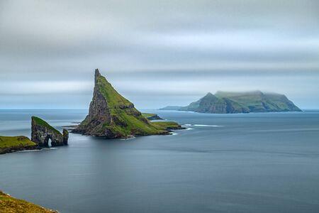 Amazing top view long exposure of Drangarnir gate, Tindholmur and Mykines, Faroe Islands
